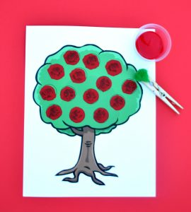 Free printable kid art project using pom poms to make apples on this apple tree.