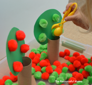 Apple sensory bin great fine motor and color matching practice.