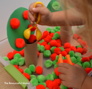 Apple sensory bin perfect for fine motor and color matching practice.