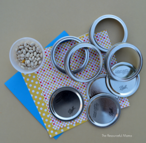 Make New Year's Eve shakers/noisemakers from mason jar lids for kids.