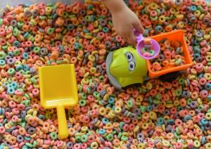 Rainbow sensory bin fun indoor activity.