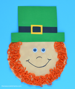 Paper plate leprechaun kid craft with a yarn beard for St. Patrick's Day