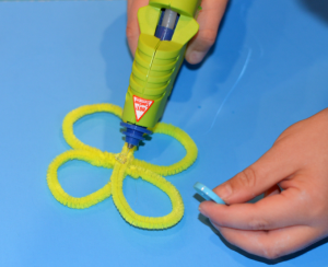 These pipe cleaner flowers are a fun and colorful flower craft for kids and a great kid made Mother's Day gift.