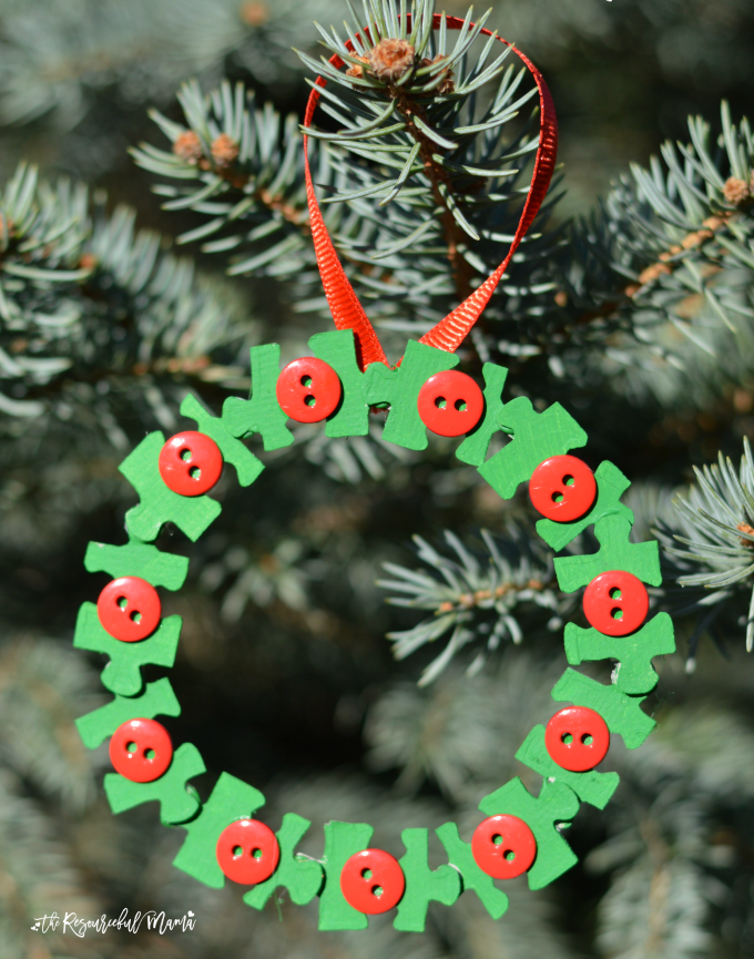 Transform puzzle old pieces and buttons into a lovely kid make wreath ornament for the Christmas tree.