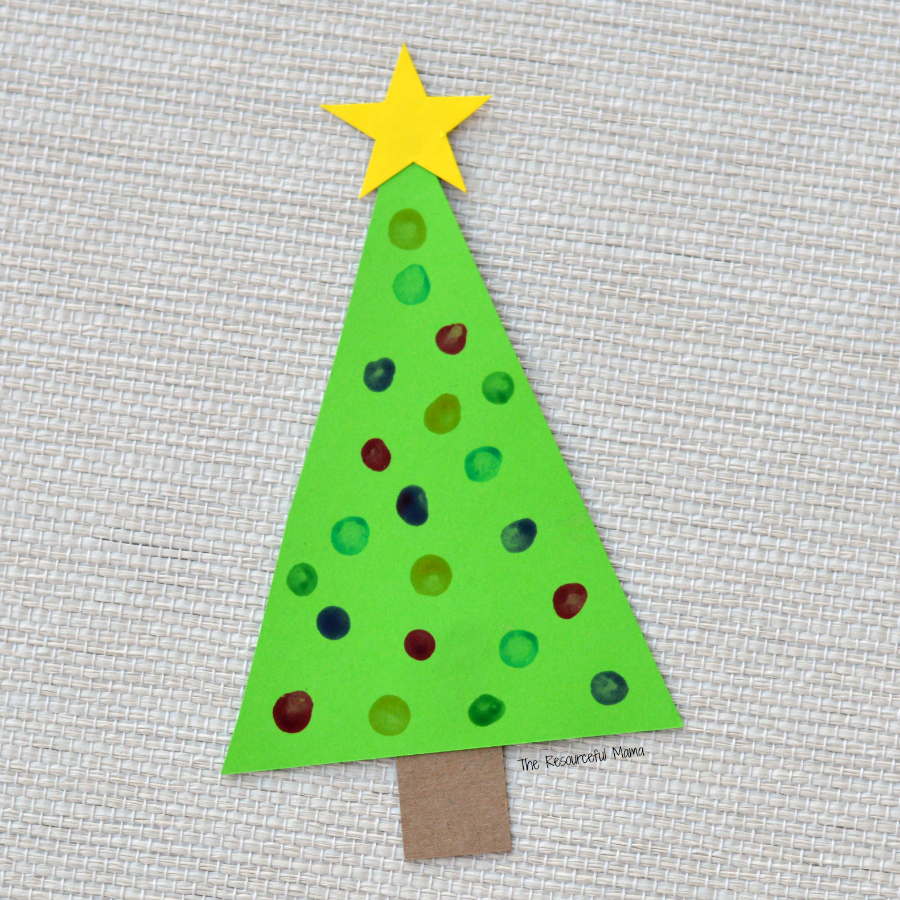 This Christmas tree craft is an easy low prep craft that kids can do independently and then turn into an ornament for your Christmas tree or a decoration for your wall or board. q-tip painting