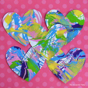 These spin art hearts create a stunning and colorful process art activity for Valentine's Day. kids artwork