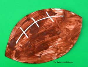 sponge painted football by a preschooler