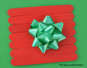 This craft sticks (or popsicles stick) Christmas gift kid craft project is super easy, fun, festive, and inexpensive. The materials can be purchased at the Dollar Store.