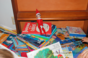 The Elf on the Shelf has been reading and he made a mess of the books