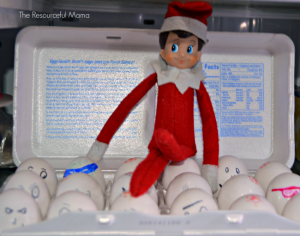 The Elf on the Shelf pulled the markers and drew faces on the eggs.