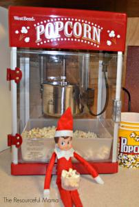 Elf on the shelf and popcorn machine.