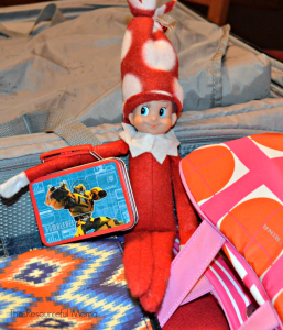 The Elf on the Shelf has his suitcase and is ready for the trip.