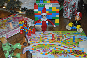 Elf on the Shelf playing Candy Land with his friends