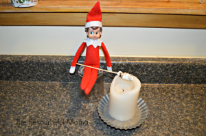 Elf on the Shelf roasting marchmallows