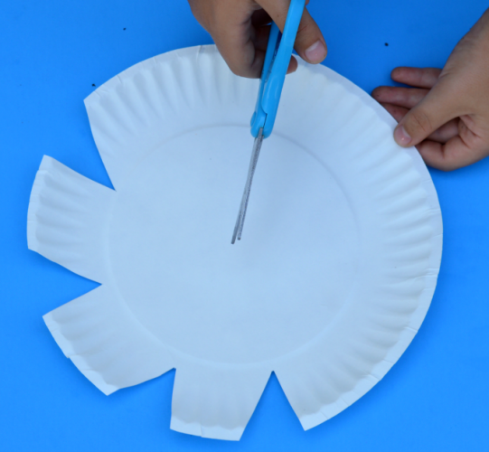 Paint the craft stick green and the paper plate yellow and allow to dry. & Paper Plate Sunflower Craft - The Resourceful Mama