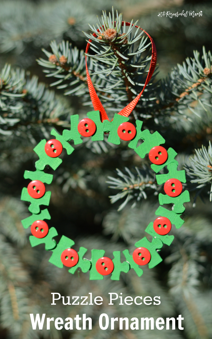 Transform old puzzle pieces and buouzttons into a lovely kid make wreath ornament for the Christmas tree.