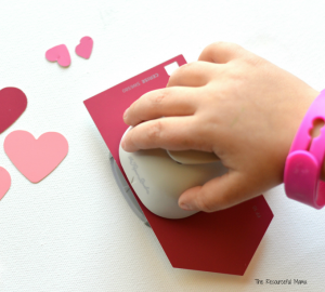 Turn heart craft punches and paint chips into a Valentine's Day fine motor activity for young kids.