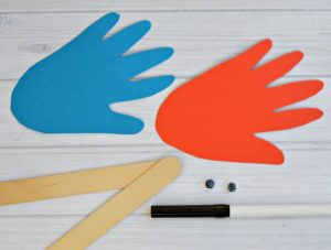 Cute handprint fish puppets inspired by Dr. Seuss One Fish Two Fish Red Fish Blue Fish. kid craft | book inspired craft | book extension activity