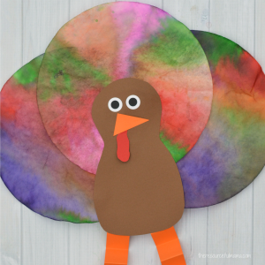 This Coffee Filter Turkey Craft is a quick, easy, and inexpensive craft kids can make for Thanksgiving. It uses a fun technique to color the coffee filters.