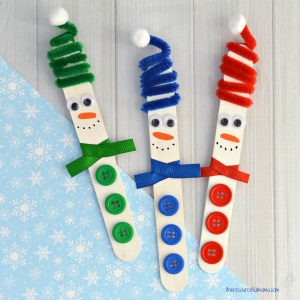 This Craft Stick Snowman with a fun spiral pipe cleaner hat is a really cute craft kids can make this winter and looks lovely hanging from the Christmas tree.