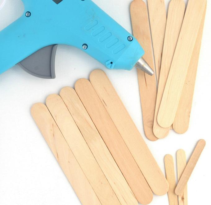 Transform craft sticks into a cardinal craft for kids.